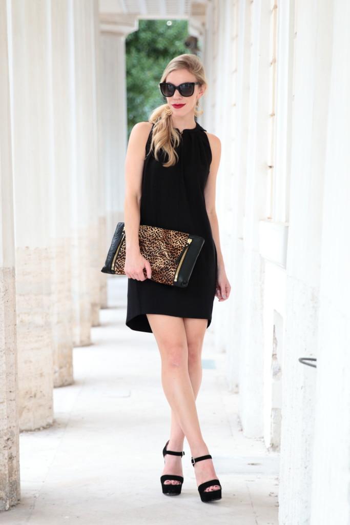 Leopard: Black dress, Oversized clutch