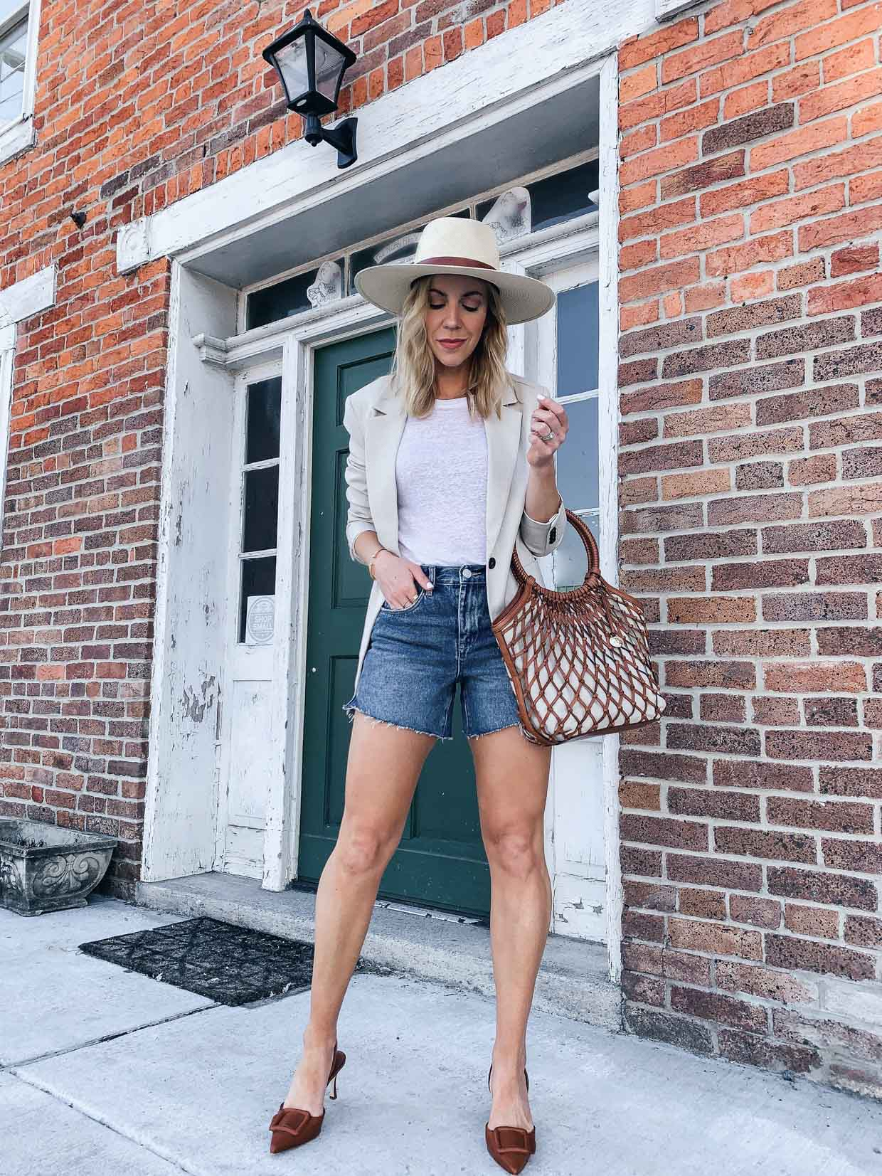 Meagan Brandon fashion blogger of Meagan's Moda wears H&M beige blazer for summer with white tee and denim shorts