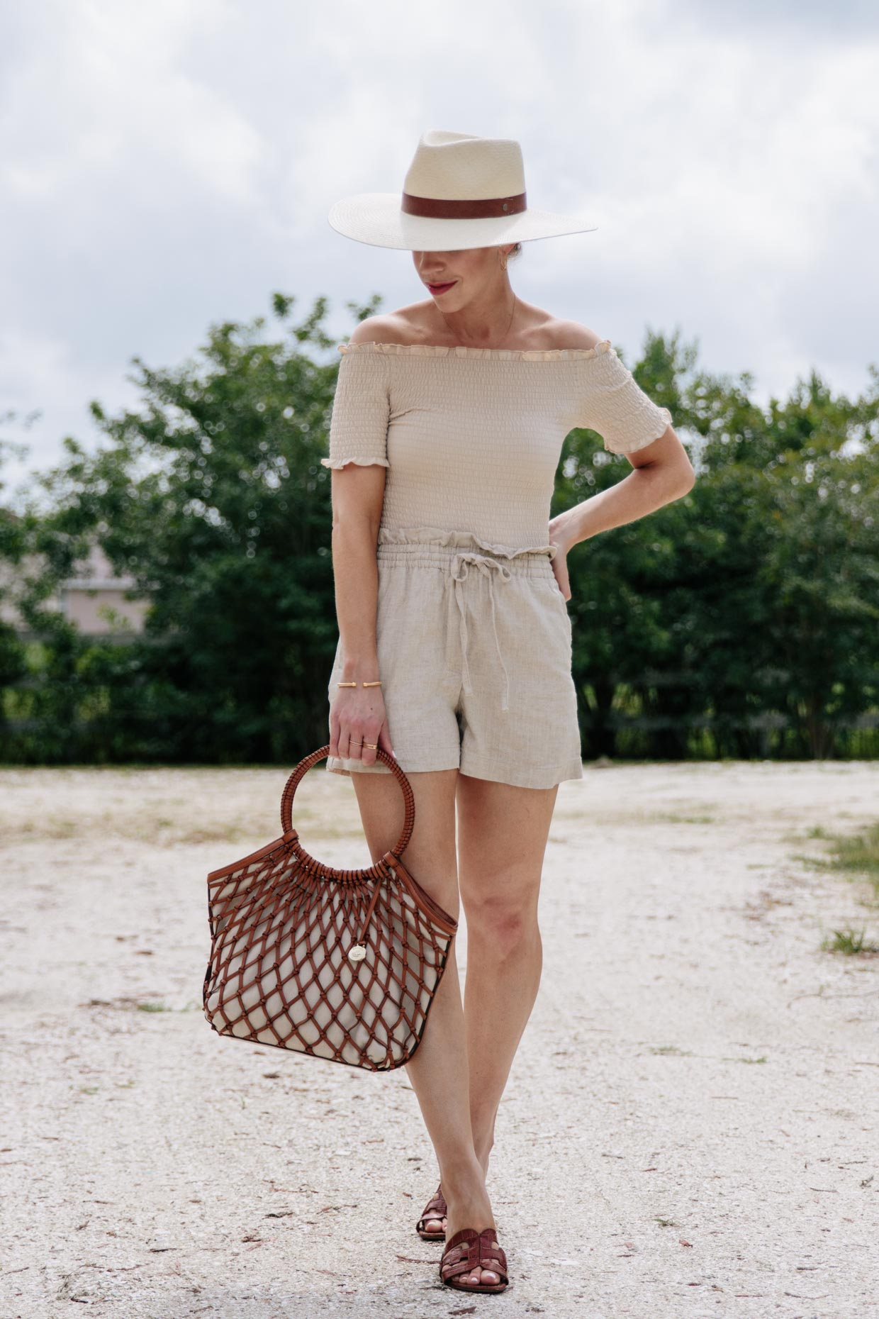 Meagan Brandon fashion blogger of Meagan's Moda wears beige monochrome outfit with off the shoulder top and high waist linen shorts