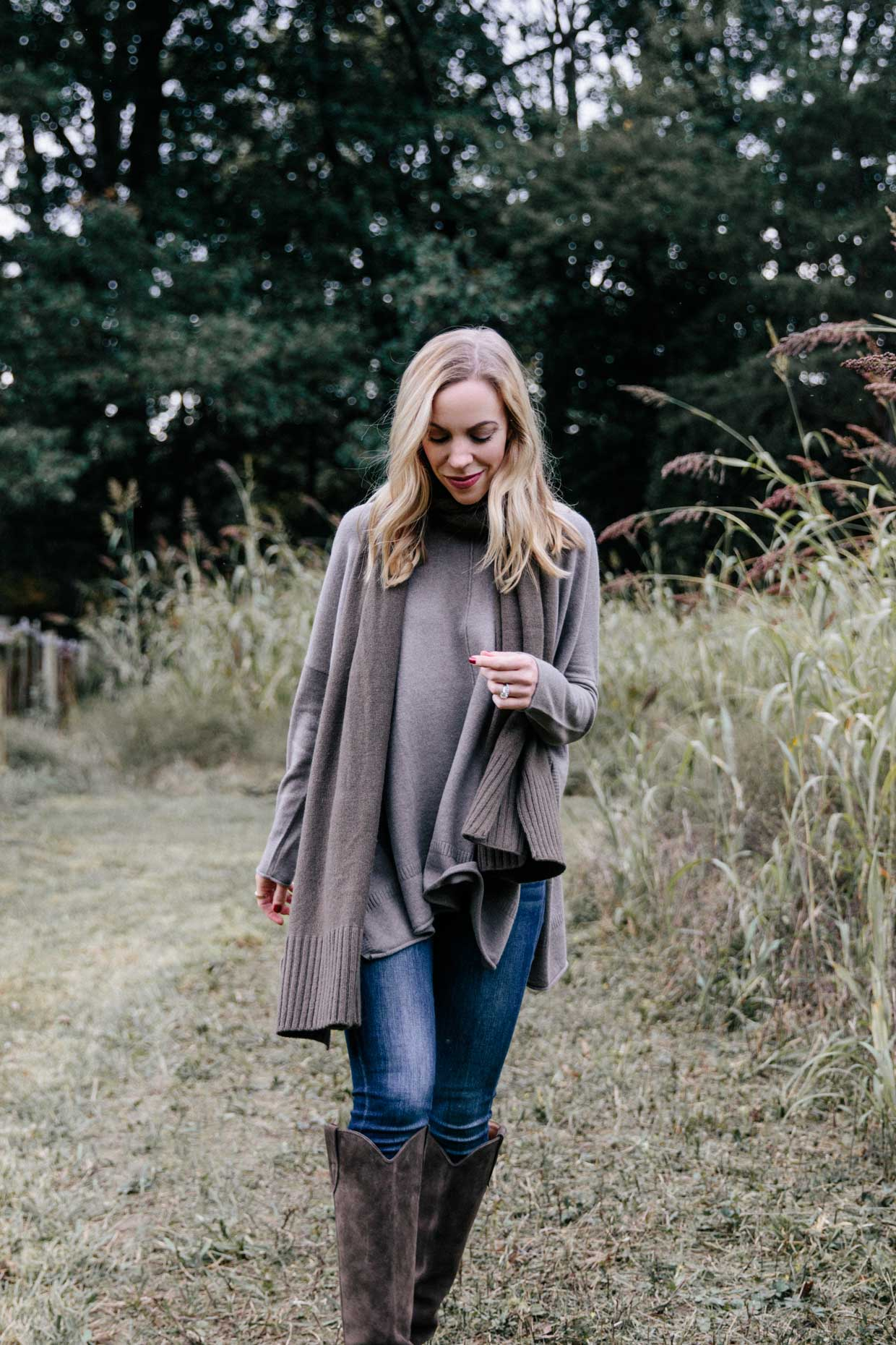 Meagan Brandon fashion blogger of Meagan's Moda wears State Cashmere oversized sweater with olive green scarf and western boots
