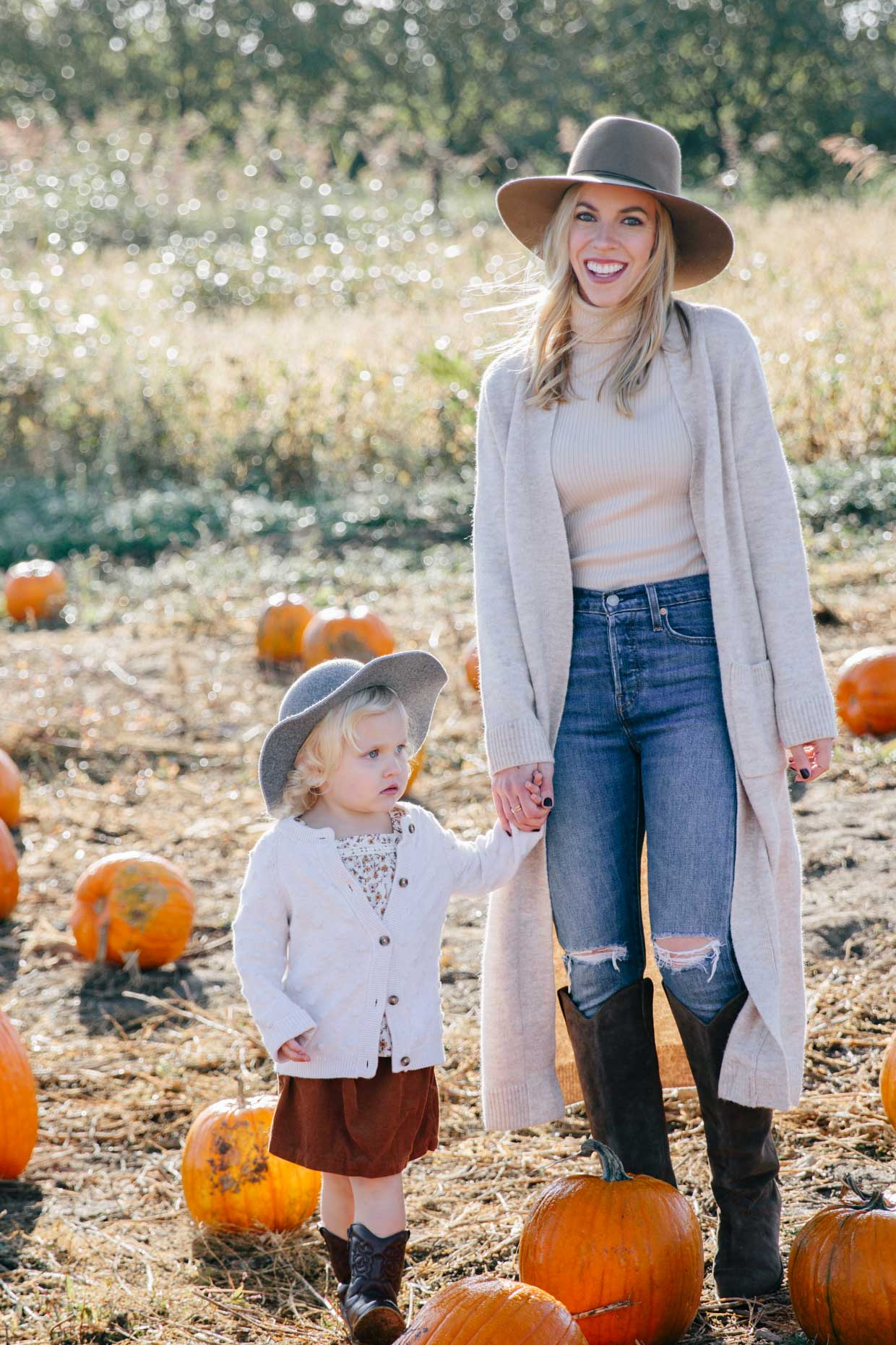 Meagan Brandon fashion blogger of Meagan's Moda wears Zara long beige cardigan with beige turtleneck and skinny jeans at pumpkin patch