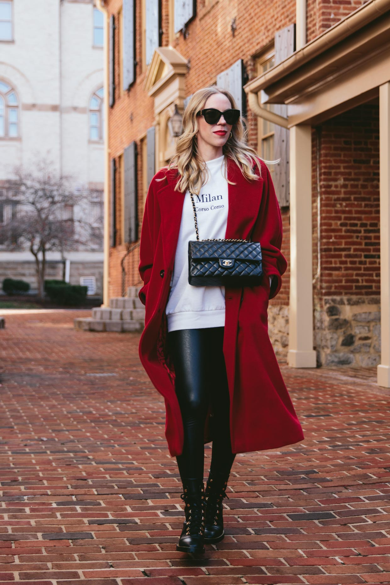 Meagan Brandon fashion blogger of Meagan's Moda wears Max Mara 101801 red coat with faux leather leggings and Chanel classic flap bag