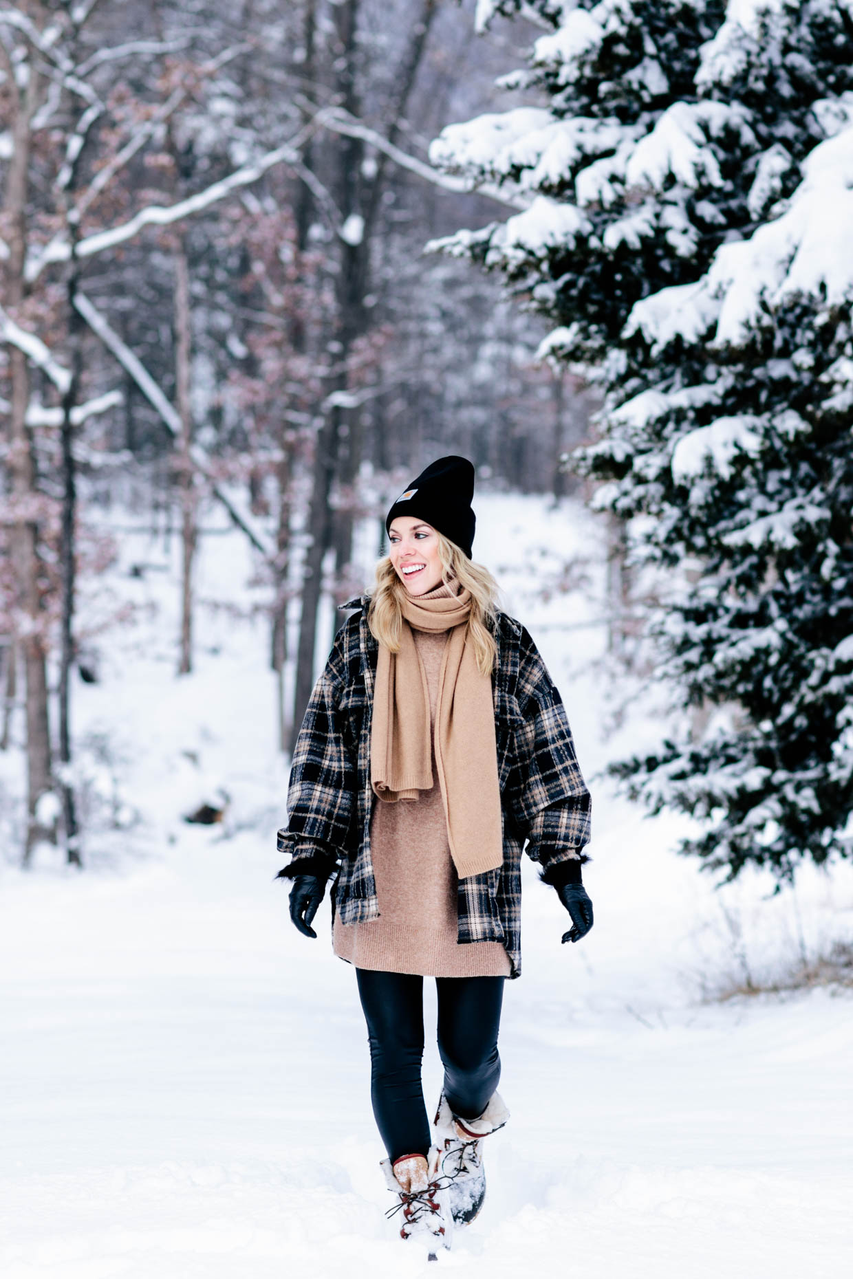 Meagan Brandon fashion blogger of Meagan's Moda wears Chicwish plaid shacket with camel scarf, Plush fleece lined faux leather leggings winter outfit
