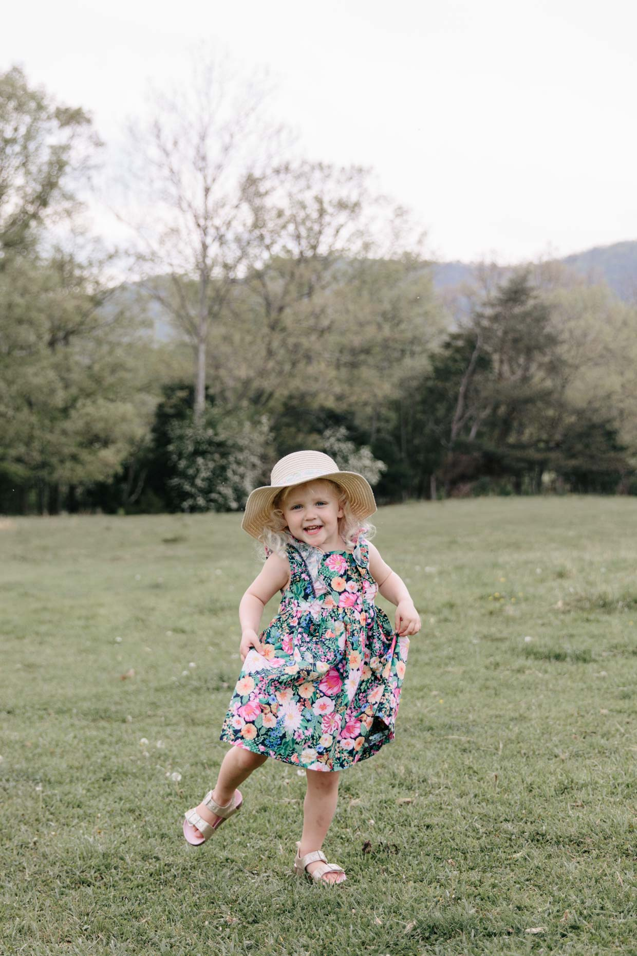 Meagan Brandon fashion blogger of Meagan's Moda shares toddler girl style for Mother's Day photo shoot floral dresses and straw hats